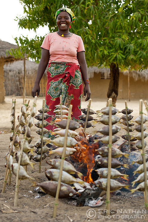 Woman cooking fish in Guludo village in the Quirimbas National Park in northern Mozambique.