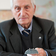 VENICE, ITALY - APRIL 03:  Ê Auschwitz Survivor Antonio Boldrin poses for a portrait while holding the metal stamp with his concentration camp number on April 3, 2012 in Venice, Italy. Sentenced to death and already in front of the execution fire squad Boldrin was rescued by the Russian Army and was one of the few lucky prisoners that managed to survive the concentration camp.  (Photo by Marco Secchi/Getty Images)