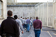 Prisoners escorted by officers move around HMP/YOI Portland, a resettlement prison with a capacity for 530 prisoners. Dorset, United Kingdom.