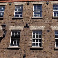 Europe, Ireland, Dublin. Windows and brick.
