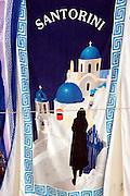 Towel for sale at a tourist shop in Oia, Santorini, Greece
