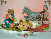 Nativity scene with Christmas wreaths and sparkles.
