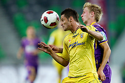 Wilson Juninho of NK Domzale vs Robert Beric of Maribor during football match between NK Domzale and NK Maribor in final match of Hervis Cup, on May 25, 2011 in SRC Stozice, Ljubljana, Slovenia. Domzale defeated Maribor and became Slovenian Cup Champion 2011. (Photo By Vid Ponikvar / Sportida.com)