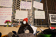 02 APRIL 2021 - MINNEAPOLIS, MINNESOTA: GRACE BUSSE, from the Twin Cities, chained herself to the perimeter fence around the Hennepin County Courthouse. She is one of the protesters at the courthouse. Protesters are keeping a 24 hour presence in front of the Hennepin County Courthouse in Minneapolis during the murder trial of former Minneapolis Police Officer Derek Chauvin. Chauvin is on trial for murdering George Floyd in 2020. Floyd's death, while restrained and in police custody, set off a summer of racial justice protests across the United States.      PHOTO BY JACK KURTZ