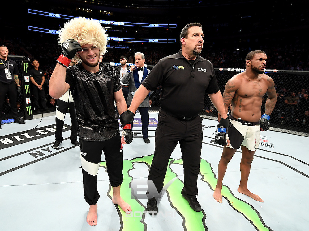 NEW YORK, NY - NOVEMBER 12:  Khabib Nurmagomedov of Russia (left) is awarded victory by KO over Michael Johnson of the United States in their lightweight bout during the UFC 205 event at Madison Square Garden on November 12, 2016 in New York City.  (Photo by Jeff Bottari/Zuffa LLC/Zuffa LLC via Getty Images)