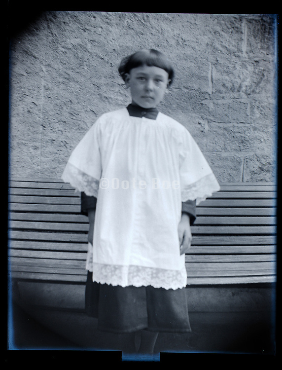 boy in altar boy clothing France 1926
