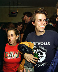 MR TOM PARKER BOWLES son of Camilla Parker Bowles, and MISS CHLOE SALMON, at a party in London on 22nd October 1997.MCJ 59