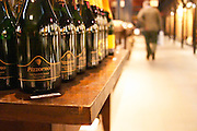 A selection of Uruguayan sparkling wine: Pizzorno, Castelar and others. A man walking in the background Montevideo, Uruguay, South America Uruguay wine production institute Instituto Nacional de Vitivinicultura INAVI