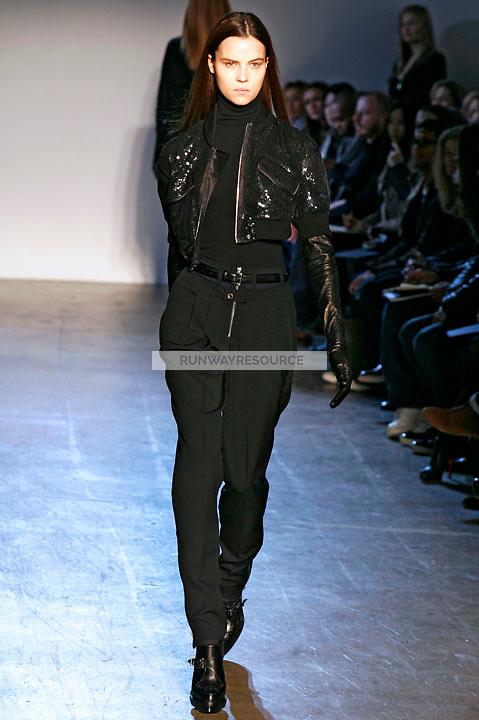 Egle Tvirbutaite walks the runway wearing Phi Fall 2009 collection