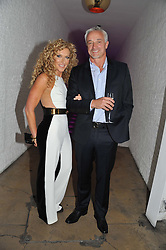 KELLY HOPPEN and JOHN GARDINER at a party to celebrate the Kelly Hoppen and Smallbone kitchen range held at The Collection, 264 Brompton Road, London on 24th September 2012.