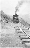 """RGS class 60 locomotive with first train through the just-opened Ames Slide.<br /> RGS  Ames, CO  6/1930<br /> In book """"Rio Grande Southern, The: An Ultimate Pictorial Study"""" page 97<br /> See RD155-078 for original.<br /> Also in """"RGS Story Vol. III"""", p.68 and """"RGS Story Vol. X"""", p. 244."""