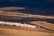 tractor plowing field and turning up dust for winter field