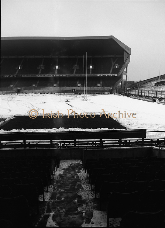 A Snowcovered Lansdowne Road..1985..18.01.1985..01.18.1985..18th January 1985..Picture shows a snowcovered  Lansdowne Road Stadium. Due to a heavy overnight snowfall the Rugby International between Ireland and England had to be cancelled. Not only was the pitch unplayable,the stands and terracing posed a serious risk to the health and safety of the expected crowd.The game was refixed for March and Ireland went on to win 13 - 10. This win secured The Triple Crown,.only a 15-15 draw with France prevented the Grand Slam.