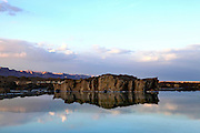 Israel, Dead sea. Rocks reflect in the still water