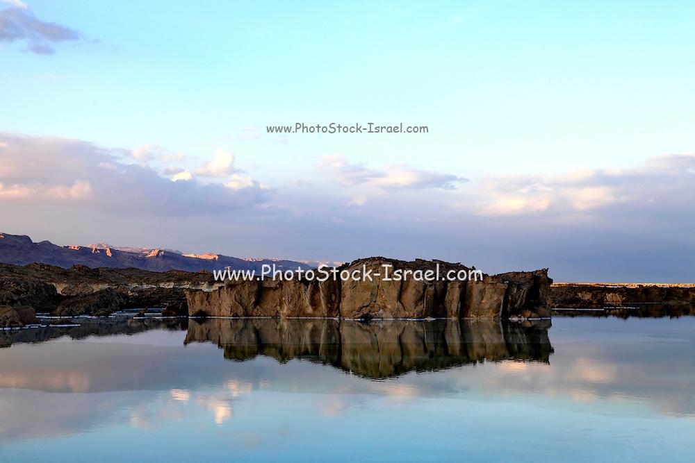 Israel, Dead sea. Rocks reflect in the still water