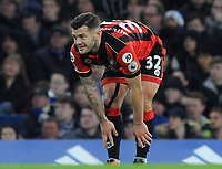 Football - 2016 / 2017 Premier League - Chelsea vs. AFC Bournemouth<br /> <br /> Jack Wilshere of Bournemouth feels his shins after another heavy tackle at Stamford Bridge.<br /> <br /> COLORSPORT/ANDREW COWIE