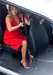 "EXCLUSIVE: Jennifer Aniston and Adam Sandler are currently filming ""Muerder Mystery"" in lake Como. Today the location was Como town. The two actors were seen arriving on set with a caddy and then fiming a very agitated scene. With a car of carabinieri (italian police) crushed on a fake monument and Sandler surrendered after a car chase for which stuntman have been used. 10 Aug 2018 Pictured: Jennifer Aniston, Adam Sandler. Photo credit: MEGA TheMegaAgency.com +1 888 505 6342"