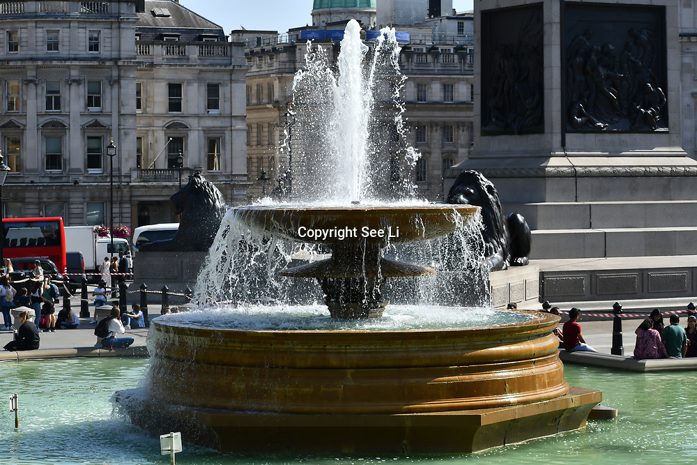 UK Weather - The Hottest week in June 2019, in Trafalgar Square fountian on 27 June 2019, London, UK