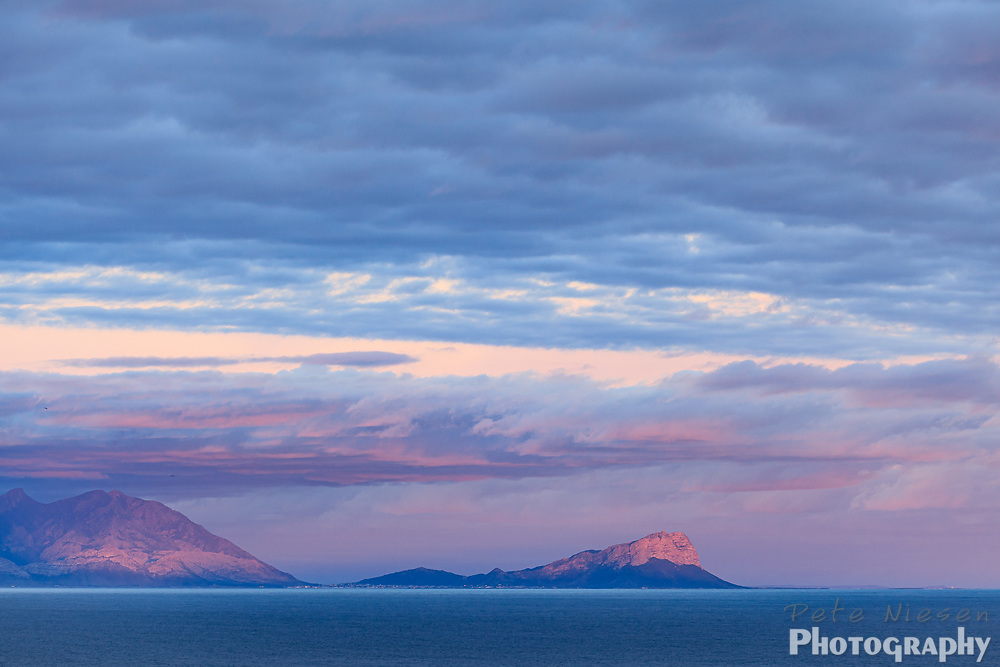 Sunset Dramatically Outlines Profile of Mountains in False Bay, South Africa