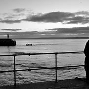 Waiting for the sun.<br /> <br /> St Ives (Cornish: Porth Ia, meaning St Ia's cove) is a seaside town, civil parish and port in Cornwall, England, United Kingdom. The town lies north of Penzance and west of Camborne on the coast of the Celtic Sea. In former times it was commercially dependent on fishing. The decline in fishing, however, caused a shift in commercial emphasis, and the town is now primarily a popular holiday resort, notably achieving the title of Best UK Seaside Town from the British Travel Awards in both 2010 and 2011. St Ives was incorporated by Royal Charter in 1639. St Ives has become renowned for its number of artists. It was named best seaside town of 2007 by the Guardian newspaper. It should not be confused with St Ive, a village and civil parish in south-east Cornwall.