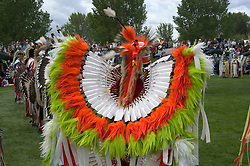 WY: Wyoming, Cody: Dancing at Plains Indian June Powwow...Photo #: yellow557..Photo copyright Lee Foster, 510/549-2202, lee@fostertravel.com, www.fostertravel.com..