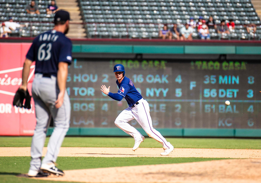 Aug 01 2019, Arlington, TX  U.S.A.  Texas first baseman Scott Heineman (16) running to third during the MLB game between the Seattle Mariners and the Texas Rangers 11-3 lost at Globe Life Park in Arlington,TX. Thurman James / CSM