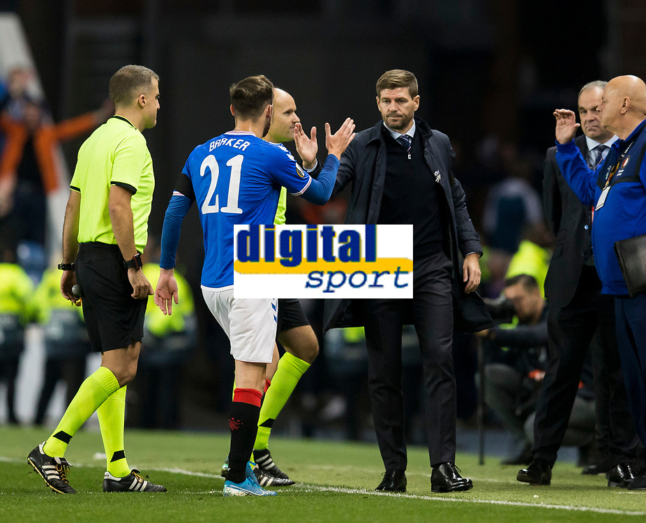 Football - 2019 / 2020 UEFA Europa League - Group G: Rangers vs. Feyenoord<br /> <br /> Rangers manager Steven Gerrard celebrates at full time with Brandon Barker of Rangers, at Ibrox<br /> COLORSPORT/BRUCE WHITE