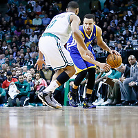 01 March 2013: Boston Celtics point guard Avery Bradley (0) defends on Golden State Warriors point guard Stephen Curry (30) during the Boston Celtics 94-86 victory over the Golden State Warriors at the TD Garden, Boston, Massachusetts, USA.