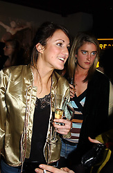 Left to right, HATTI RIKARDI and  MISS VIOLET VON WESTENHOLTZ at a party to celebrate the 4th anniversary of Quintessentially held at 11 Grosvenor Place, London  SW1 on 14th December 2004.<br />