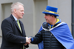 © Licensed to London News Pictures. 20/03/2019. London, UK. Bracknell MP Phillip Lee with Steve Bray, an anti-Brexit campaigner in Westminster. Dr Phillip Lee resigned last June as Justice Minister over the Government's handling of Brexit. Photo credit: Dinendra Haria/LNP