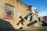 Trevor Fenner pulls a kickflip during a skate session on the angular concrete features near Garfield High School, in Seattle, Washington. Fenner, who grew up in Seattle, now lives in Los Angeles and came back for the summer to look for work.