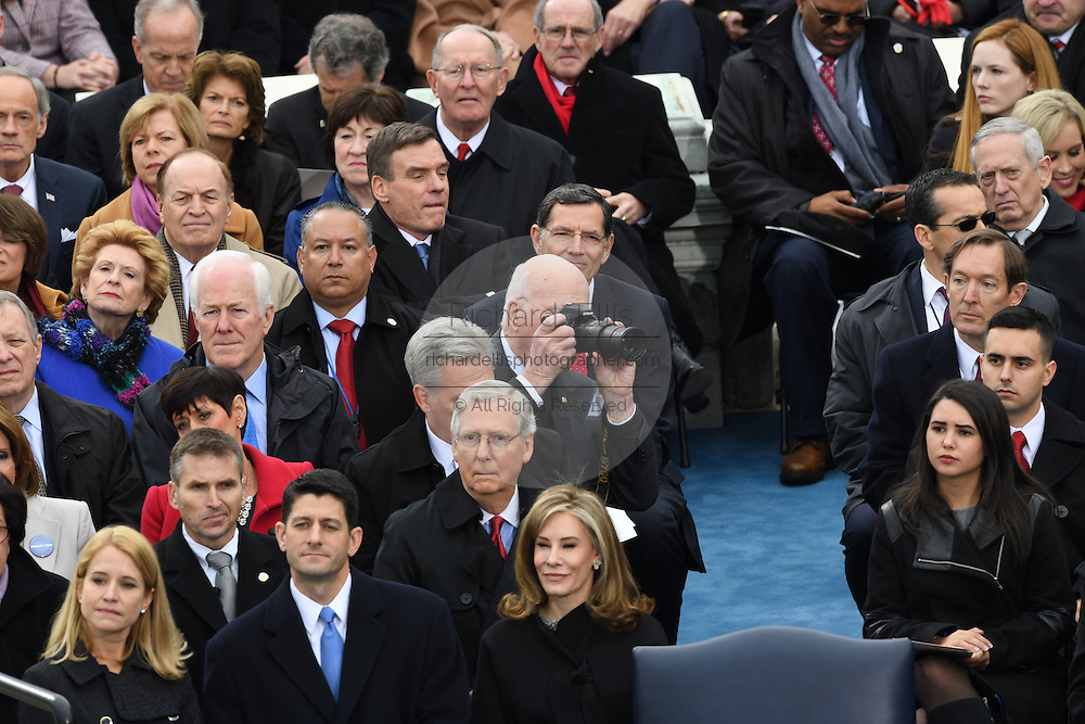 Senator Patrick Leahy takes a photo during the 68th President Inaugural Ceremony on Capitol Hill January 20, 2017 in Washington, DC. Leahy is a lifelong photographer who has been published in many publications.