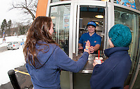 Alexa Minor serves her first customers Madi and Riley Nichols during Dairy Queen's opening day Friday afternoon.  (Karen Bobotas/for the Laconia Daily Sun)