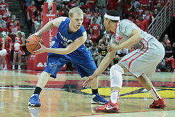 26 February 2014:  Lucas Eitel protects the ball from Zach Lofton during an NCAA Missouri Valley Conference (MVC) mens basketball game between the Indiana State Sycamores and the Illinois State Redbirds  in Redbird Arena, Normal IL.