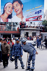 Kathmandu, 18 February 2005. Armed Police Forces patrolling the streets during the nation's Democracy Day. Since the King's declaration of 'state of emergency', the police forces operate under the Royal Nepal Army's control.