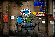 Robot and spaceship graffiti in alleyway near Sampeng market in Yaowarat, Chinatown, Bankgkok, Thailand.