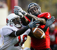 Ball State safety Douglas Owusu (16) breaks up a long pass intended for Northern Illinois receiver Keith Perry during the second quarter on November 1, 2003 in DeKalb, Illinois.