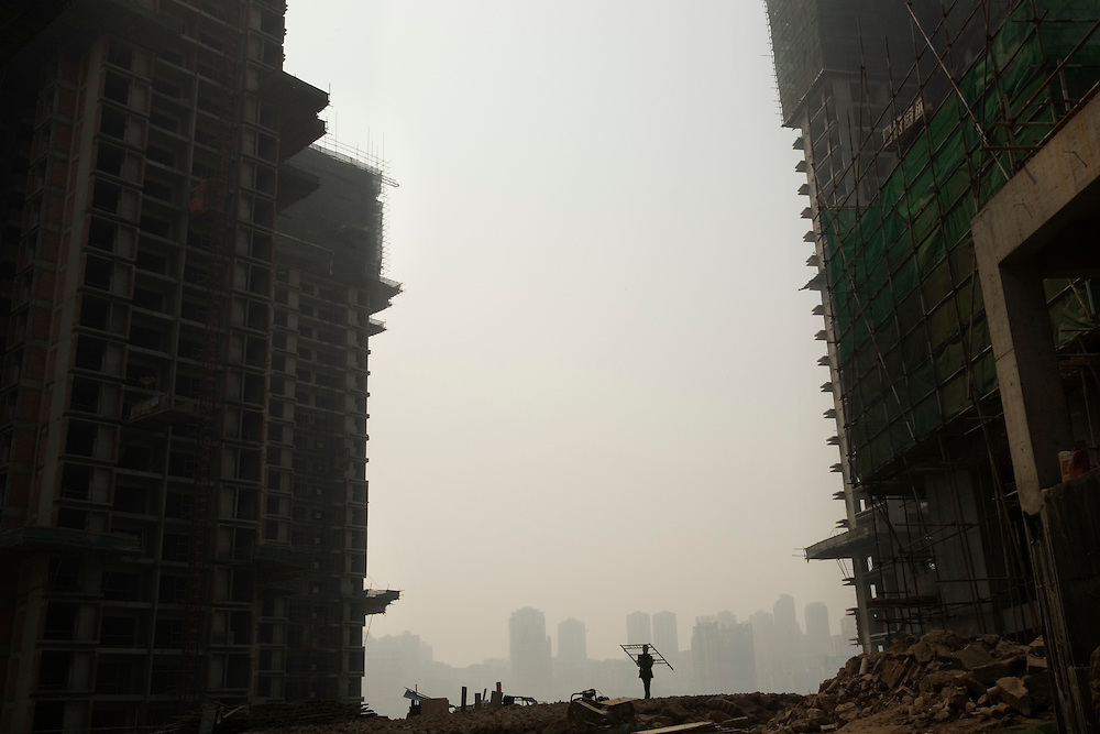 A construction worker at the Zhujiang Taiyang housing development in the Jiangbei District of Chongqing city photographed on Tuesday 20 March 2007. The city is bristling with skyscrapers both fully built and under construction.