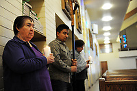 With patience and dedication, the faithful help set the stage for Ash Wednesday services at St. Mary's in Salinas.