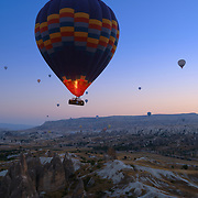 Hot air balloon fly in the morning over valley in Cappadocia, Turkey