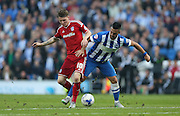 Cardiff City striker Joe Mason and Brighton central midfielder, Beram Kayal battle for possession during the Sky Bet Championship match between Brighton and Hove Albion and Cardiff City at the American Express Community Stadium, Brighton and Hove, England on 3 October 2015.