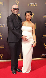 Michelle Ang and boyfriend attending The 2016 Creative Arts Emmy Awards at the Microsoft Theatre in Los Angeles, USA.