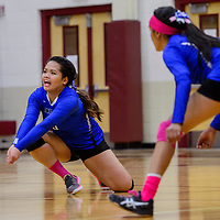 Navajo Pine Warrior Pearly Artieda (6) reaches for a serve from the Ramah Mustangs Tuesday at Ramah High School.
