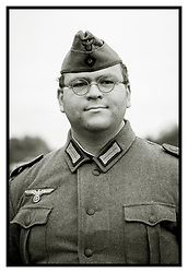 A reenactor from the Northern World War Two Association Portrays a German soldier, wearing the early war side cap or Feldmutze, 'M40' tunic, and period correct glasses<br /> <br />   24 September 2017 <br />   Copyright Paul David Drabble<br />   www.pauldaviddrabble.co.uk