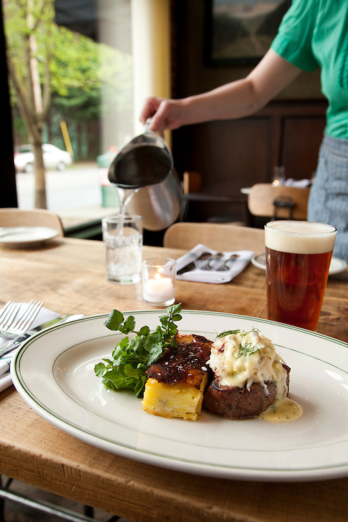 Beef Tenderloin with Dungeness Crab, Bernaisse Sauce and potato gratin, garnished with watercress. Paired with a Double Mountain IRA, from Hood River Oregon.