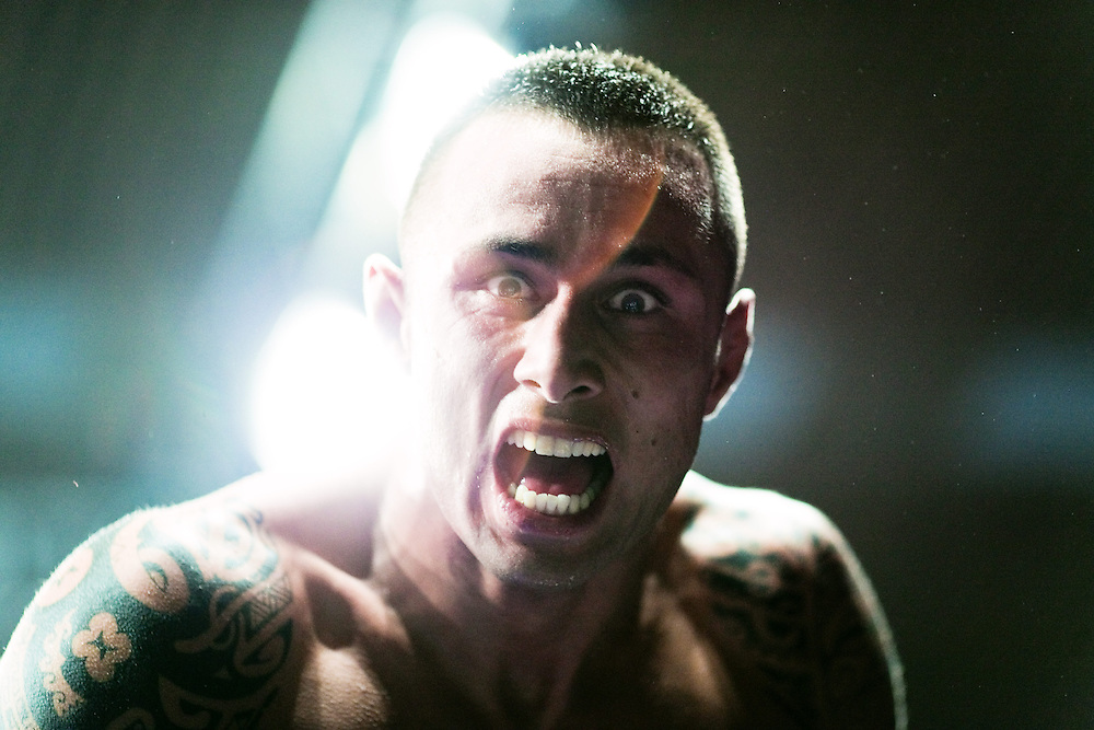 MMA fighter Billy Echter cries out after his victory in the ring.