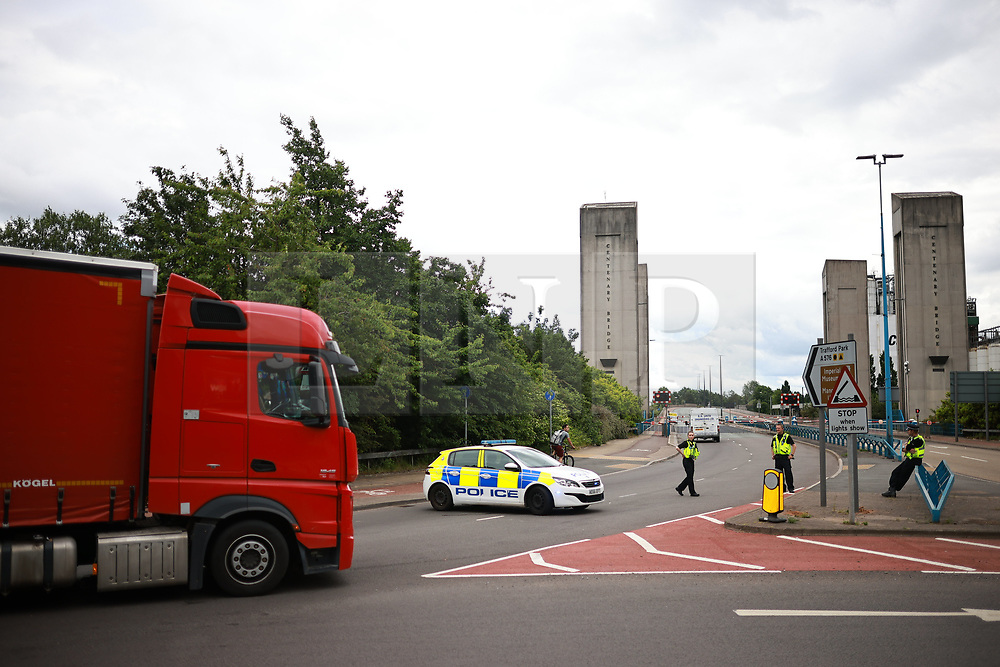 © Licensed to London News Pictures. 09/06/2021. Manchester, UK. The Centenary Way lift bridge is closed to all traffic, causing large rush hour traffic delays. It's understood debris was seen falling from the deck and engineers are investigating whether it is safe and secure. Photo credit: Joel Goodman/LNP