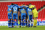 Shrewsbury Town players in pre match huddle during the The FA Cup 3rd round replay match between Stoke City and Shrewsbury Town at the Bet365 Stadium, Stoke-on-Trent, England on 15 January 2019.