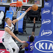 ORLANDO, FL - MARCH 01: Kristaps Porzingis #6 of the Dallas Mavericks blocks a shot by Terrence Ross #31 of the Orlando Magic during the second half at Amway Center on March 1, 2021 in Orlando, Florida. NOTE TO USER: User expressly acknowledges and agrees that, by downloading and or using this photograph, User is consenting to the terms and conditions of the Getty Images License Agreement. (Photo by Alex Menendez/Getty Images)*** Local Caption *** Kristaps Porzingis; Terrence Ross