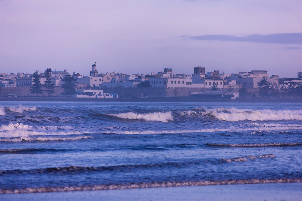 Beach with city view at dawn in Essaouira, Morocco.